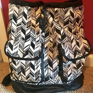 Black and white arrow design backpack